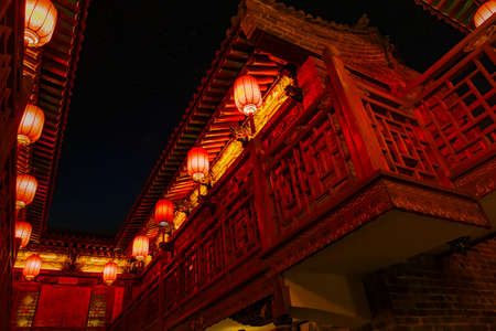 Typical balconies and terraces of an old traditional Chinese style house. In the dark sky background, it is distinguished in the light of the stars Editorial