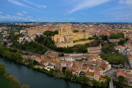 Aerial view of Beziers city: Saint Nazaire Cathedral, river and bridges. A landscape from France.