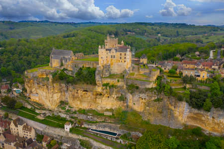 Aerial landscape. Ancient medieval Castle of Beynac stands on a top of a hill over the Dordogne river. Beynac et Cazenac is a village labeled Most beautiful villages of France.
