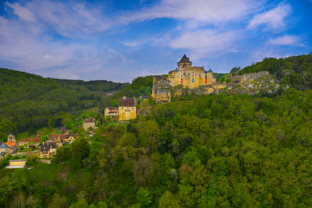 Aerial panorama of a medieval chateau in Castelnaud - La Chapelle. The village and castle are located above the confluence of the two rivers. Dordogne department in Nouvelle-Aquitaine in southwestern France. Editorial