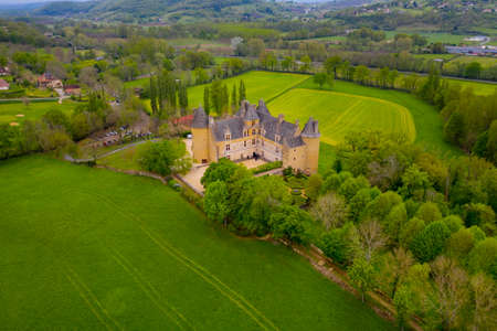 Aerial view of Castle of Montal in Saint-Jean-Lespinasse, Lot department. Southern France. The outdoor sculptures also make Montal a truly unique château