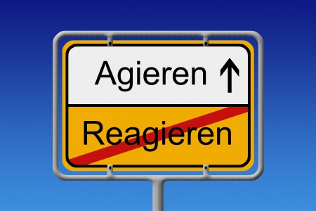 react: Illustration of a German City Sign with the words Agieren - Reagieren   act - react   Stock Photo