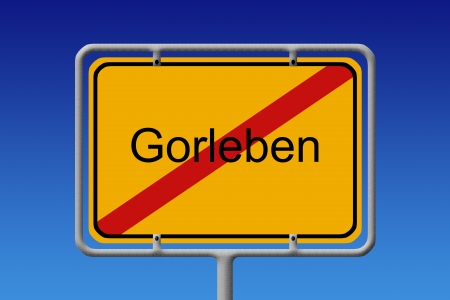 interim: Illustration of a German city sign with the word Gorleben crossed out  highly controversial interim storage facility for radioactive waste in germany  Stock Photo
