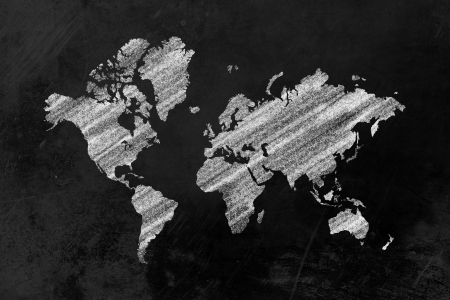 the shape of the world map drawn on a blackboard photo