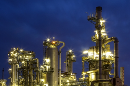 An illuminated chemical plant during twilight hour photo