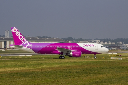 HAMBURG, GERMANY - JULY 25: A brand new Airbus A320 returns from a test flight to the Airbus Plant in Hamburg Finkenwerder on July 25, 2013 Peach Aviation is a Japanese Low cost airline Editorial