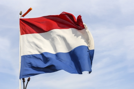 A Giant dutch flag on blue skies Stock Photo