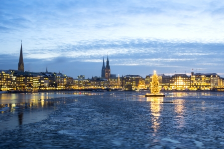hamburg: The Hamburg Alster lake with ice and Christmas tree in Advent Stock Photo