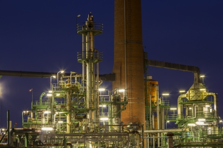 An illuminated chemical plant at night Stock Photo