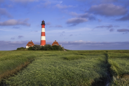 westerhever: The Lighthouse of Westerhever at the German North Sea Coast during Sunrise Stock Photo