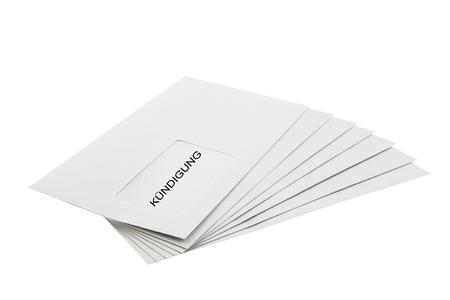 dismissal: Kundigung (German dismissal) written on a Batch of Envelopes  Stock Photo