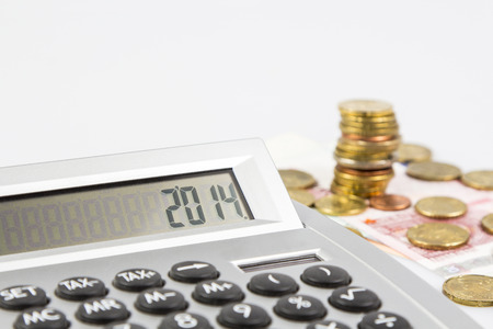 Une calculatrice avec la monnaie europ�enne Banque d'images