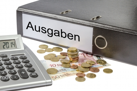 A Binder labeled wit the word Ausgaben (German expenses), calculator and european currency  photo