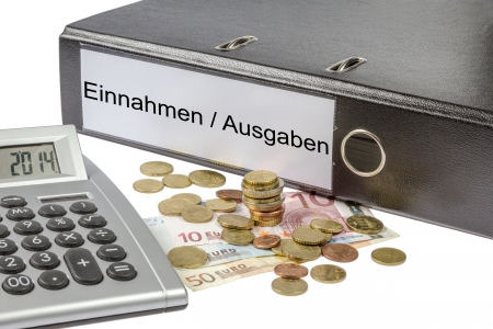 A Binder labeled wit the words Einnahme Ausgabe  German revenue expense  calculator and european currency  photo