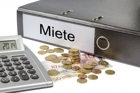 A Binder labeled wit the word miete  German Rent , calculator and european currency  Stock Photo