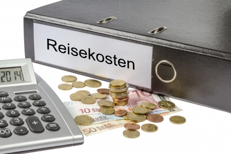 A Binder labeled wit the word reisekosten  German  travel expenses , calculator and european currency  photo