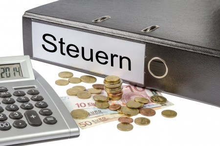 A Binder labeled wit the word Steuern  German Taxes , calculator and european currency photo