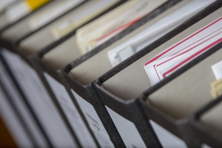 A Row of binders with sheets and files in an office archive, shallow depth of field Stock Photo