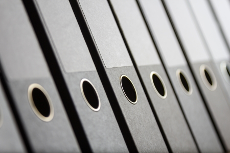 A Row of binders in an office archive, shallow depth of field Stock Photo