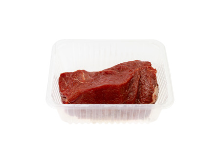 Raw Beef from the supermarket in a plastic dish isolated on white Background photo