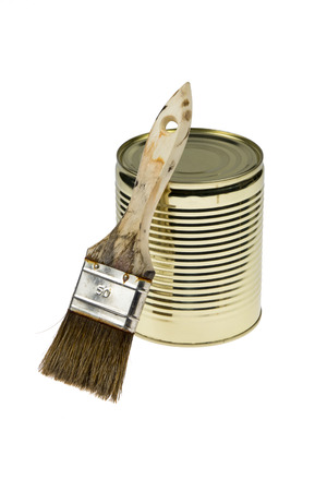 Metallic Can of paint with a used brush isolated on white background photo