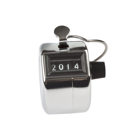 Hand held tally counter showing 2014 isolated on white background photo