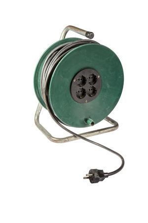 usado tambor de cable verde aislado en el fondo blanco photo