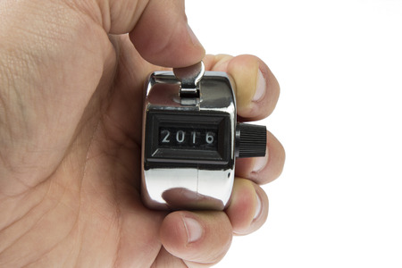 Hand held tally counter showing 2016 holded by male hand isolated on white background photo