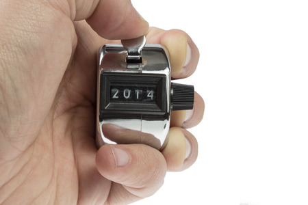 Hand held tally counter showing 2014 holded by male hand isolated on white background photo
