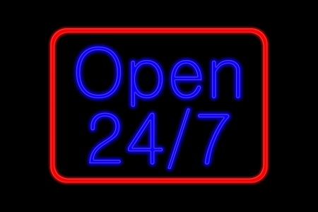 Illuminated Neon sign with blue Letters and red frame showing open 24 7 isolated on black background Stock Photo
