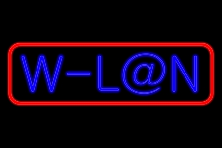 wlan: Illuminated Neon sign with blue Letters and red frame showing w-lan with at sign as a isolated on black background Stock Photo
