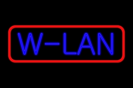 wlan: Illuminated Neon sign with blue Letters and red frame showing w-lan isolated on black background