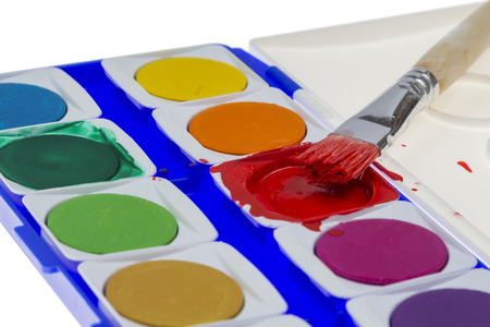 paintbox: Used Paintbox with brush at the red colour isolated on white  Stock Photo