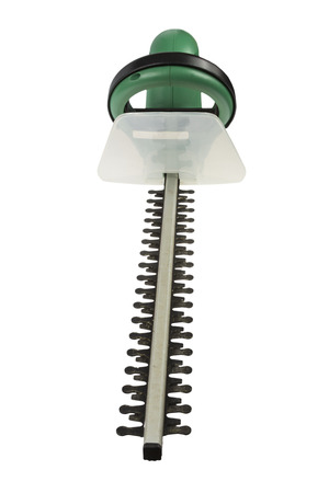 hedge clippers: Used electrical hedge clippers with black blades and green engine case isolated on white