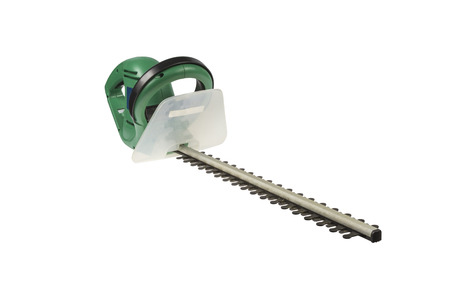 Used electrical hedge clippers with black blades and green engine case isolated on white  Stock Photo - 25860698