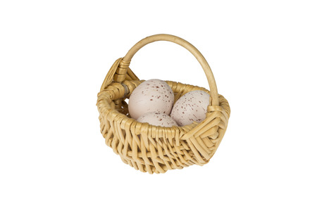 Miniature Basket with three quail eggs isolated on white background
