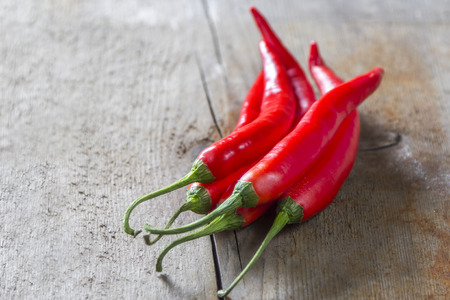 bunch of red chillies on rustic wooden background