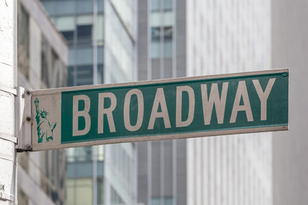 manhattans: Roadsign of Manhattans famous Broadway with blurred background