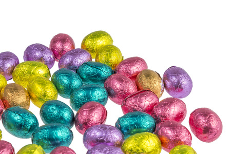 chocolate easter eggs wrapped in colorful aluminum foil isolated on white background