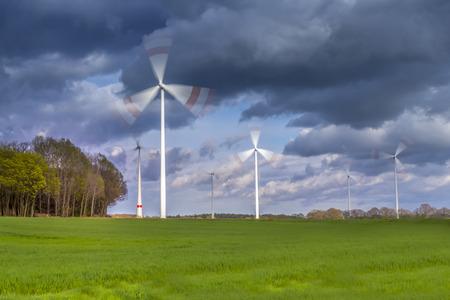 powerplants: moving windmill powerplants on a green meadow