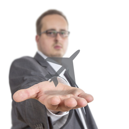 reaches: Business man reaches out his arm with an aircraft symbol floating over his hand. Isolated on White Background