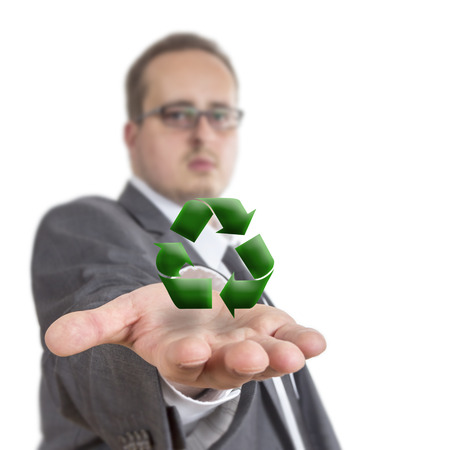 environmental suit: Business man reaches out his arm with a XXX symbol floating over his hand. Isolated on White Background Stock Photo
