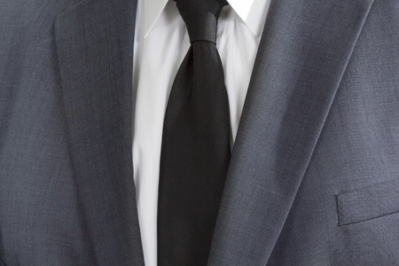man in suite: Detail of a man wearing a suite with white shirt and black tie