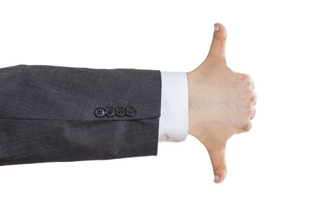 Isolated arm of a business man in suite showing thumb up and down gesture with one hand photo