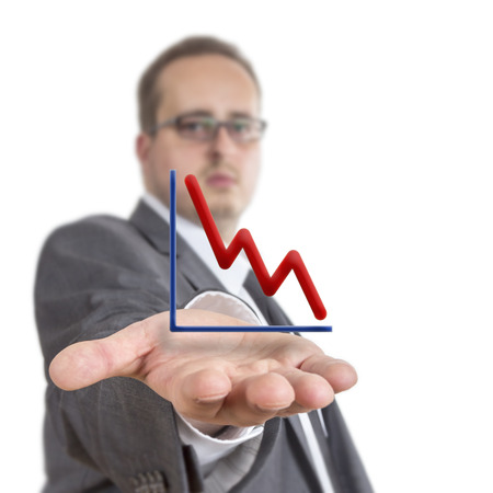 downwards: Business man reaches out his arm with a stock exchange graph going downwards  floating over his hand. Isolated on White Background