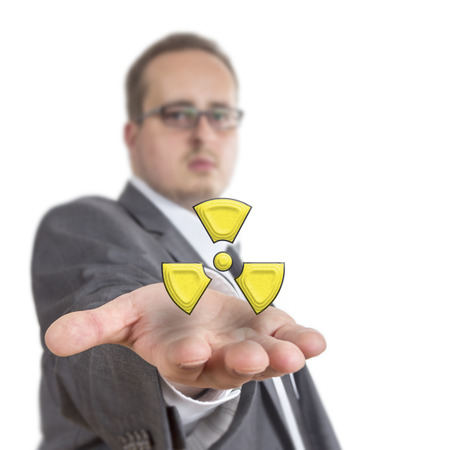 Business man reaches out his arm with a radioactive symbol floating over his hand. Isolated on White Background photo