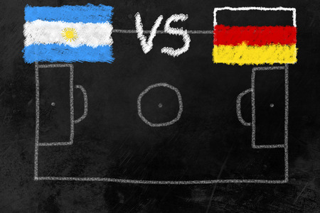 Soccer field on a black board with flags of Argentina and Germany, the finalists of the soccer tournament. Stock Photo