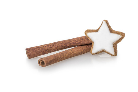bisquit: Cinnamon sticks with star shaped cinnamon bisquit isolated on white background Stock Photo