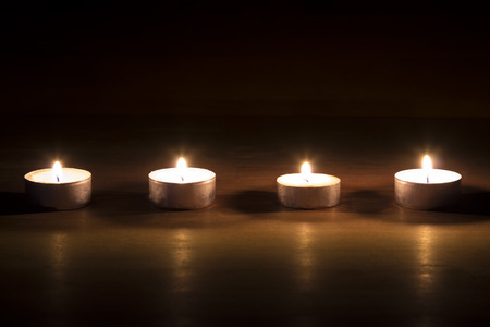 tera: Row of wooden tera candles on wooden background