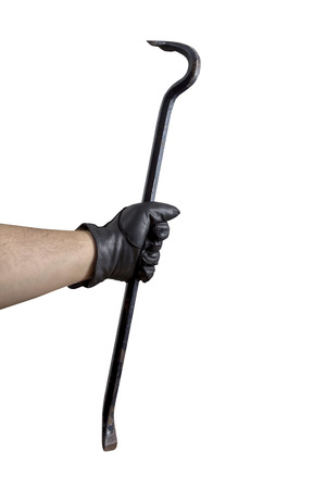 A Hand in black leather gloves holding a cow bar photo
